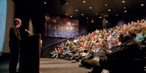 Michael Murphy speaking before a 200-person audience in Washington, D.C.